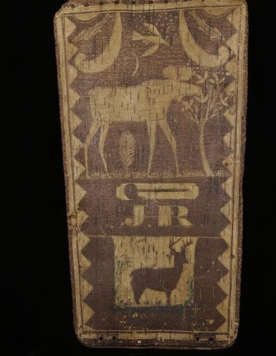 "Birchbark canoe rest with design. Includes geometric shapes, animals, and the initials ""J.R."""